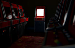 Arcade Aisle With One Illuminated. A 3D render of an aisle of switched off vintage arcade game machines with one at the end with an illuminated screen in a retro Stock Image