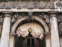 Arcade Arch, Saint Mark`s Square, Venice, Italy. An ornate arched entrance, with cloth awning, to the shopping and cafe arcade surrounding St Mark`s Square Stock Photos