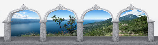 Arcade with archway and garda lake landscape Stock Images