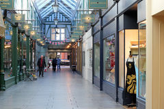The arcade, Bedford, UK. The arcade Bedford. This is a very old shopping arcade in the town center running off the High Street. There are numerous shops Royalty Free Stock Images