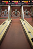 Arcade Carnival Game. A midway carnival Skeeball bowling amusement game at an arcade in which the player rolls a ball and tries to win tickets Royalty Free Stock Images