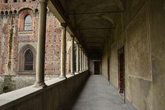 Arcade in the Castello Sforzesco. Milan, Italy - October 2, 2015: Empty arcade corridor outside the Castello Sforzesco in the Sempione Park in the center Stock Image