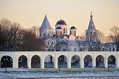 Arcade and churches of Yaroslav's Courtyard at winter sunset, Veliky Novgorod, Russia Royalty Free Stock Photos