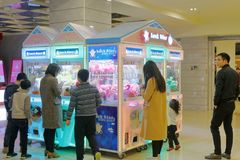 The arcade claw machine toys crane game, adobe rgb. Arcade claw machine toys crane game in zhonghuacheng mall, xiamen city, china. both adults and children love royalty free stock photos