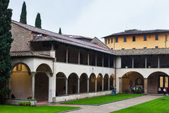 Arcade of cloister of Basilica di Santa Croce. FLORENCE, ITALY - NOVEMBER 6, 2016: arcade of Arnolfo`s cloister of Basilica di Santa Croce Basilica of the Holy Stock Images