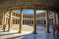 Arcade with columns of Alhambra palace Charles V in Granada. And. GRANADA, SPAIN - OCTOBER 28,2016: Atrium with columns of Alhambra palace Charles V {Palacio de Royalty Free Stock Images
