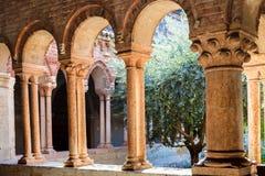Arcade in court of Basilica di San Zeno in Verona. VERONA, ITALY - MARCH 27, 2017: arcade in court of Basilica di San Zeno San Zeno Maggiore, San Zenone in Royalty Free Stock Photos