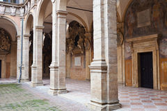 Arcade and courtyard of Archiginnasio palace, Bologna. Medieval courtyard of Archiginnasio palace - the first official headquarter for the world oldest Stock Photography