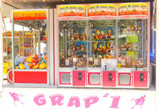 Arcade crane claw machine. Paris, France - July 9, 2015: Arcade crane claw machine on an arcade at amusement park in Jardin des Tuileries, Paris Royalty Free Stock Photos