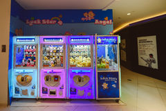 Arcade crane claw machine. SHANGHAI, CHINA - MAY 04, 2016: Arcade crane claw machine in Shanghai, China Royalty Free Stock Photography