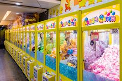 Arcade crane game. TAIPEI, TAIWAN - JULY 11: This is an arcade with crane games where people can win toys which are common across night markets in Taiwan on July Royalty Free Stock Photography