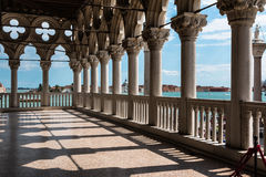 Arcade of the Doge`s Palace: Gothic architecture in Venice, Ital. Arcade - Internal View from Doge`s Palace, Gothic architecture in Venice, Italy Stock Photo