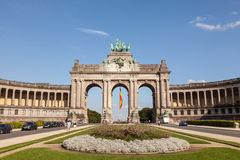 Arcade du Cinquantenaire in Brussels, Belgium. BRUSSELS, BELGIUM - AUG 21: Triumphal arch Arcade du Cinquantenaire in the center of Cinquantenaire park in Stock Photos