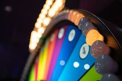 Arcade gambling machine with big wheel stock images