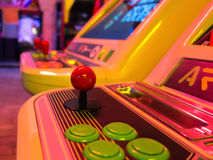 Arcade game machine. Detail of an arcade game machine with essential components: a joystick and a group of buttons. Classic Stock Photo