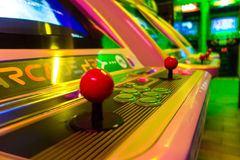 Arcade game machine. Detail of an arcade game machine with essential components: a joystick and a group of buttons. Classic Stock Images