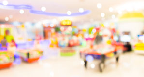 Arcade game machine shop blur background with bokeh image. Arcade game machine shop blur background with bokeh image Royalty Free Stock Image