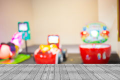 Arcade game machine shop blur background with bokeh image Royalty Free Stock Photos