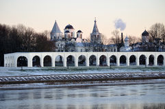 Arcade if ancient trades and churches of Yaroslav's Courtyard at winter sunset, Veliky Novgorod, Russia. Anceint arcade and churches of Yaroslav's Courtyard  at Royalty Free Stock Photos