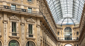 Arcade inside the city centre of milano. These beautiful arcades are stunning, and the light from the roof windows give  this soft light towards the facades Stock Photo