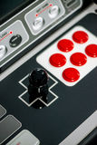 Arcade joystick. Detail of a black joystick and red buttons on an arcade game machine Royalty Free Stock Photography