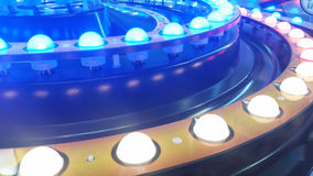 Arcade lights bulbs circle. Inside an arcade game with lights and reflections and blue light bulbs Royalty Free Stock Photography
