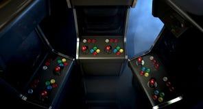 Arcade Machine Group Huddle Immagine Stock
