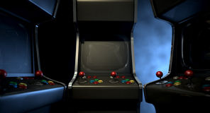 Arcade Machine Group Huddle Royalty Free Stock Photography
