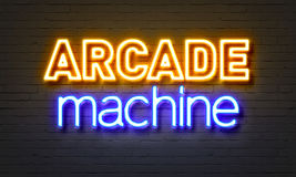 Arcade machine neon sign on brick wall background. Stock Images