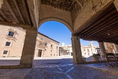 Arcade of main square in Penaranda de Duero. Village, with Palace of the Counts of Miranda, in Burgos, Castile and Leon, Spain, Europe Royalty Free Stock Photography