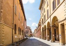 Arcade in medieval street, Bologna, Italy Stock Photos