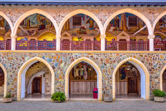Arcade with mosaics inlaid with gold in monastery. CYPRUS, PAPHOS- MAY 2 2016: Arcade with mosaics inlaid with gold in the famous Kykkos monastery Royalty Free Stock Image