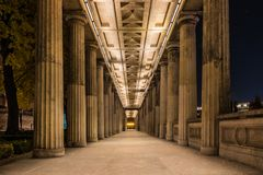 arcade of national galery in berlin by night stock photo