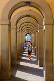 Arcade in the old town of Florence, Italy. Florence, Italy - July 04, 2016: arcade in the old town of Florence with unidentified people. In medieval time Stock Photos