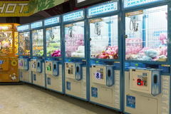 Arcade claw machine toys crane game. Robotic claw game machine in arcade. Claw crane is type of arcade game known as merchandiser, commonly found in video arcade Stock Image