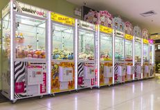 Arcade claw machine toys crane game. Robotic claw game machine in arcade. Claw crane is type of arcade game known as merchandiser, commonly found in video arcade Stock Photography