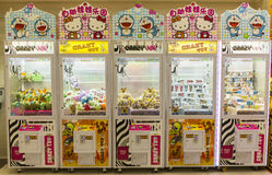 Arcade claw machine toys crane game. Robotic claw game machine in arcade. Claw crane is type of arcade game known as merchandiser, commonly found in video arcade Royalty Free Stock Photography