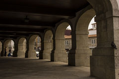 Arcade's architecture. A building with stone arcades in Caminha - Portugal Royalty Free Stock Photography