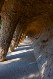 Arcade of stone columns in Park Guell, Gaudi Stock Photos
