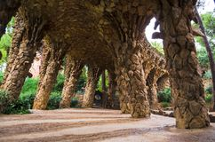 Arcade in Tunnel Rock Trail of Antonio Gaudi inside Park Guell, Barcelona, Spain. View of arcade in Tunnel Rock Trail of Antonio Gaudi inside Park Guell Stock Photos