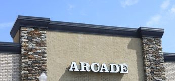 Arcade. An arcade is a venue where people play arcade games such as video games, pinball machines, electro-mechanical games, redemption games, merchandisers such Stock Photos