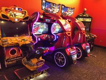 Arcade Video Games. With Shining Displays in a Dark Gaming Room Stock Photography