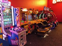 Arcade Video Games. With Shining Displays in a Dark Gaming Room Stock Photos