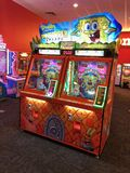 Arcade Video Games. With Shining Displays in a Dark Gaming Room Royalty Free Stock Photography