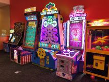 Arcade Video Games. With Shining Displays in a Dark Gaming Room Stock Photo