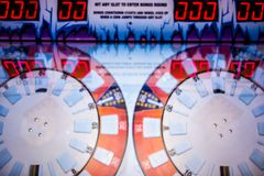 Arcade video games and lights and spinning wheels. Arcade video games and lights and spinning  wheels Royalty Free Stock Image