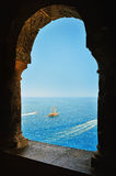 Arcade window and view of the sea. With yacht Stock Photo