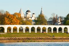 Arcade of Yaroslav Courtyard and ancient St Nicholas cathedral with towers, Veliky Novgorod, Russia. Arcade of Yaroslav Courtyard and St Nicholas cathedral with Stock Images