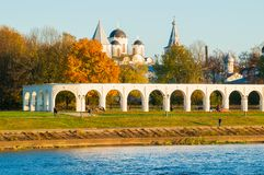 Arcade of Yaroslav Courtyard and ancient St Nicholas cathedral, Veliky Novgorod, Russia. Arcade of Yaroslav Courtyard and St Nicholas cathedral in Veliky Stock Photos