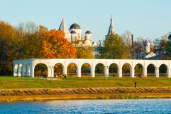 Arcade of Yaroslav Courtyard and ancient St Nicholas cathedral, Veliky Novgorod, Russia. Architecture autumn landscape. Arcade of Yaroslav Courtyard and St Royalty Free Stock Photos